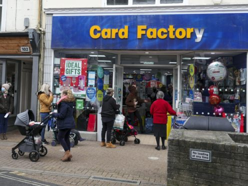 Shoppers queue for the Card Factory shop in Newport, Isle of Wight (Steve Parsons/PA)