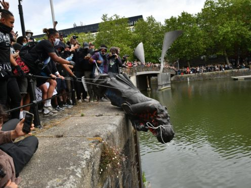 A statue of Edward Colston was dumped into Bristol harbour during a Black Lives Matter protest rally (Ben Birchall/PA)