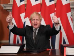 Prime Minister Boris Johnson gives a thumbs up gesture after signing the EU-UK Trade and Co-operation Agreement (Leon Neal/PA)