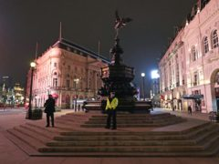 Police at the statue of Eros in Piccadilly Circus in London (Jonathan Brady/PA)