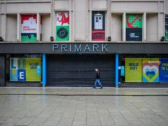 People in an almost empty central shopping area of Cardiff (Ben Birchall/PA)