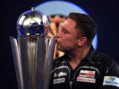 Gerwyn Price celebrates after winning the PDC World Championship for the first time (Adam Davy/PA)