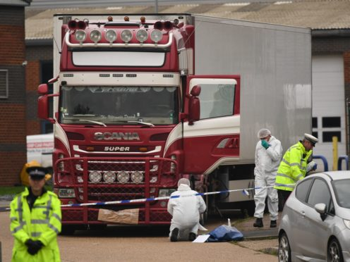 Police and forensic officers at the scene (Stefan Rousseau/PA)