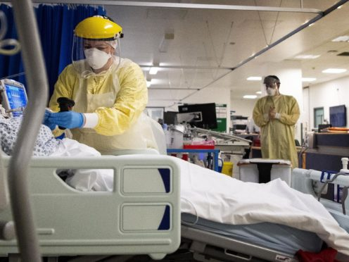A nurse works on a patient in an ICU (PA)