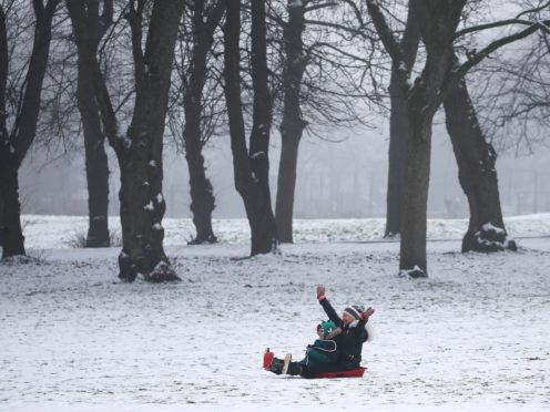 People sledging in Queen's Park in Glasgow (Andrew Milligan/PA)