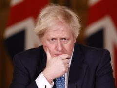 Boris Johnson struggles with names of Covid-19 drugs (Tolga Akmen/PA)