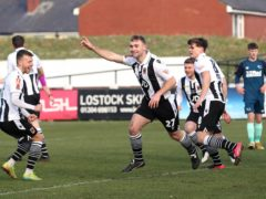 Chorley's Connor Hall, centre, opened the scoring against Derby (Martin Rickett/PA)