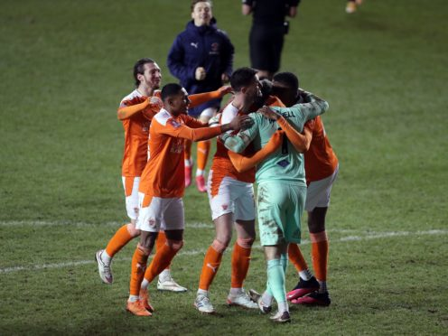 Blackpool goalkeeper Chris Maxwell celebrates with his team-mates after the shootout (Richard Sellers/PA)