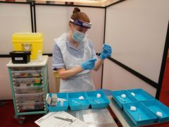 Covid-19 vaccines being prepared for health and social care workers at the Centre for Life in Newcastle (Owen Humphreys/PA)