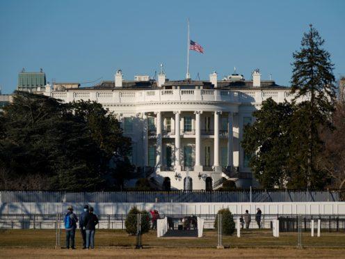 An American flag flies at half-mast above the White House (Patrick Semansky/AP)