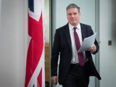 Labour leader Sir Keir Starmer arrives to deliver a virtual speech on securing the economy for families during lockdown at Labour headquarters in central London (Stefan Rousseau/PA)