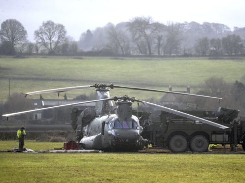 Cranes at the site where the RAF Chinook helicopter got stuck in mud (Steve Parsons/PA)
