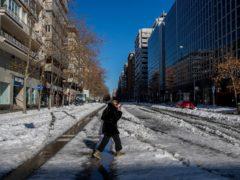 A woman walks through the snow in Madrid, Spain (Manu Fernandez/AP)