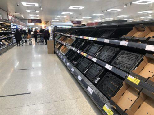Depleted supermarket shelves (David Young/PA)