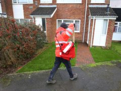 A Royal Mail delivery worker in Ashford, Kent, during England's third national lockdown to curb the spread of coronavirus (Gareth Fuller/PA)