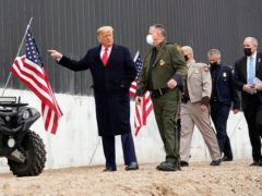 President Donald Trump tours a section of the border wall (Alex Brandon/AP)