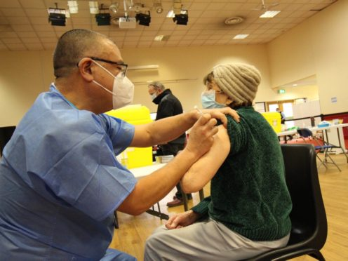 Deputy chief medical officer for England Jonathan Van-Tam assisting with the Covid-19 vaccination programme at the Richard Herrod Centre in Nottingham (NHS Nottingham and Nottinghamshire CCG/PA)