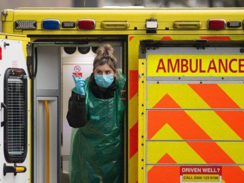 A paramedic in the rear bay of an ambulance outside the Royal London Hospital (Dominic Lipinski/PA)