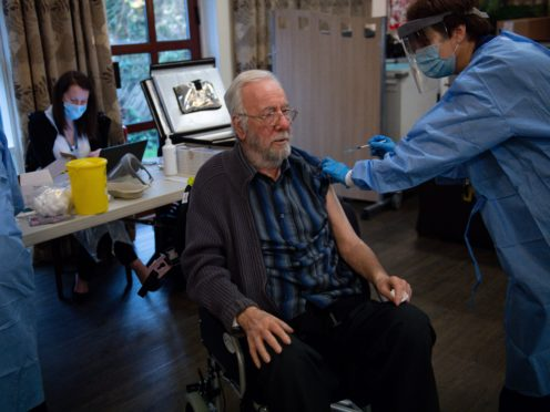 Care home resident Michael Starr receives his Oxford jab (Jacob King/PA)