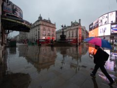 A man walks through a near empty Piccadilly Circus, in London, during England's third national lockdown to curb the spread of coronavirus (PA)