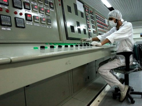 A technician works at the uranium conversion facility just outside the city of Isfahan, Iran (Vahid Salemi/AP)