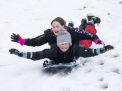 Eliza Riba-Segues, 12, left, and Laiya Grant, 11, from Penicuik, sledge at Glencourse Golf Course near Penicuik, Midlothian (Jane Barlow/PA)