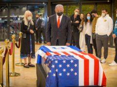 Israeli prime minister Benjamin Netanyahu stands before the coffin of Sheldon Adelson (Ami Shooman/AP)