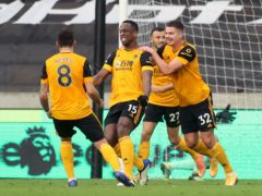 Wolves players celebrate with Willy Boly after he put them ahead against West Brom. (Carl Recine/PA)