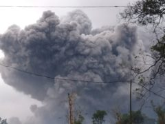 Mount Semeru spews volcanic material during an eruption in Lumajang (National Disaster Mitigation Agency via AP)