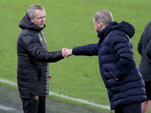 Neil Critchley bumps fists with Grant McCann (Richard Sellers/PA)