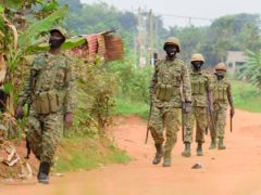 Soldiers patrol outside opposition challenger Bobi Wine's home(Nicholas Bamulanzeki/AP)