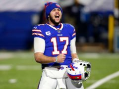 Buffalo Bills quarterback Josh Allen (17) celebrates after an NFL divisional round football game against the Baltimore Ravens (Jeffrey Barnes/AP)