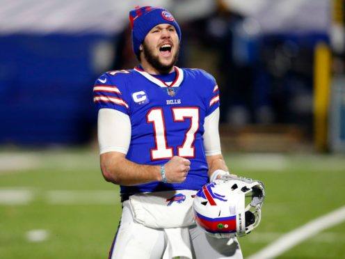 Buffalo Bills quarterback Josh Allen (17) celebrates after an NFL divisional round football game against the Baltimore Ravens (Jeffrey Barnes/AP)