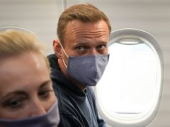 Alexei Navalny and his wife, Yulia, on the plane prior to their flight to Moscow (Mstyslav Chernov/AP)