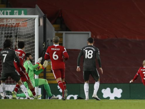 Manchester United's Paul Pogba sees his shot saved by Liverpool goalkeeper Alisson (Phil Noble/PA)