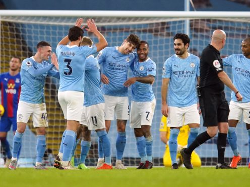 John Stones, centre, scored twice as Manchester City thrashed Crystal Palace (Dave Thompson/PA)