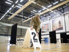Members of the Royal Scots Dragoon Guard carry out a reconnaissance before setting up a Covid-19 vaccination centre at the Ravenscraig Regional Sports Facility in Motherwell, Lanarkshire (Jane Barlow/PA)