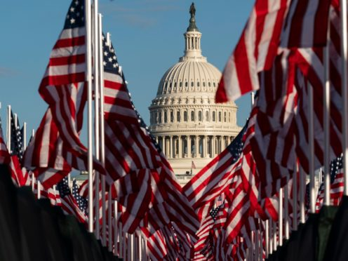 Flags are placed on the National Mall, with the US Capitol behind them, ahead of the inauguration of President-elect Joe Biden and Vice President-elect Kamala Harris (Alex Brandon/AP)