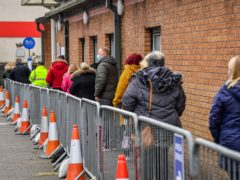 People queue for vaccines in Wales (Ben Birchall/PA)
