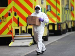 A man wearing PPE makes a delivery to the Royal London Hospital (Yui Mok/PA)