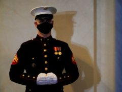 A Marine stands guard at the entrance of the West Wing of the White House, on President Donald Trump's last day in office (Gerald Herbert/AP)