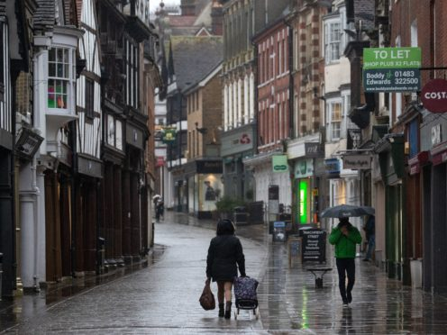 People walk up and down the High street in Winchester (PA)