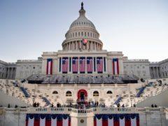 The sun rises behind the US Capitol (Caroline Brehman/Pool Photo via AP)