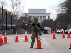 A National Guardsman stands near the US Supreme Court (AP/Gerald Herbert)