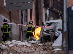 Firefighters inspect the debris caused by an explosion in Madrid, Spain (Bernat Armangue/AP)