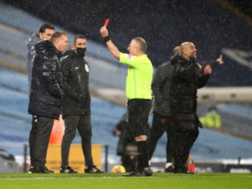 Dean Smith (left) was sent off by referee Jon Moss (Clive Brunskill/PA)