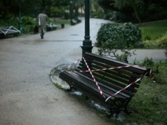 Benches are marked with tape to warn people to not use them, at a public garden in Lisbon (Armando Franca/AP)