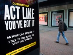 Government coronavirus sign (Andrew Matthews/PA)