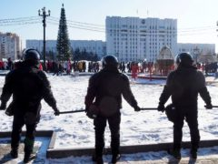 Russian riot police block a square as people gather to protest against the jailing of opposition leader Alexei Navalny in Khabarovsk (Igor Volkov/AP)