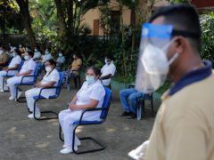Sri Lankan health officials attend a mock Covid-19 vaccination drive-in Piliyandala, Sri Lanka (Eranga Jayawardena/AP)